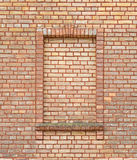 Brick wall with brick window. Abstract yellow brick wall with window texture and background Royalty Free Stock Photos