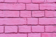 Brick wall of bricks purple streaks Stock Image