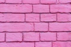 Brick wall of bricks purple streaks. Brick wall of bricks with cement purple streaks Stock Image