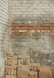 A brick wall and bricks Stock Image