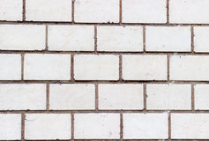 Brick wall of bricks with white. Cement streaks Stock Photo