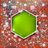 Brick wall with bright green label and fall of snow Royalty Free Stock Photography