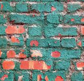 Brick Wall with Brittle Green Paint Stock Images