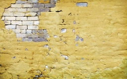 Brick wall with broken plaster Royalty Free Stock Photos