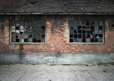 Brick wall with broken windows Stock Image
