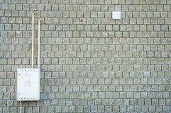 Brick wall or building facade with gas box.  stock photos