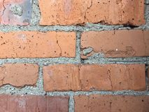 Brick wall of the building of the 60s. Red smooth brick. Ntexture, background royalty free stock images