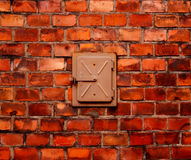 Brick wall and built steel door. Built-in metal box into a brick wall Royalty Free Stock Photo