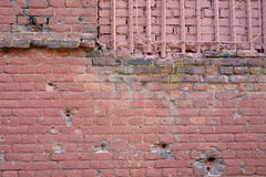 Brick wall with bullet marks Royalty Free Stock Photography