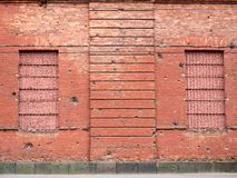 Brick wall with bullet marks. View of Brick wall with bullet marks stock images