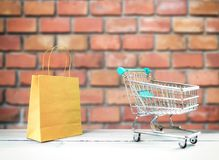 Brick wall and cart stock image