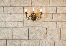 Brick wall chandelier in style of candlestick Royalty Free Stock Photo