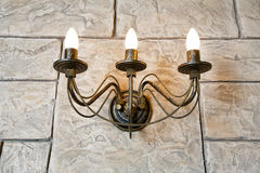 Brick wall chandelier in style of candlestick Stock Photos