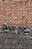 Brick Wall and Chinese Tiles Stock Images