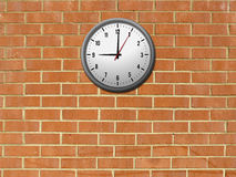 Brick wall with clock Stock Photo