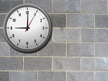 Brick wall and clock Royalty Free Stock Photos