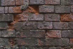 Brick wall. Close up surface of ruined brick wall stock photo