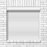 Brick wall with close window, roller shutters Stock Images