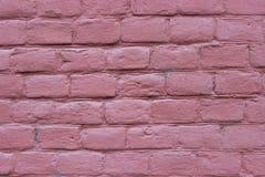 Brick wall closeup, colored pink paint royalty free stock image