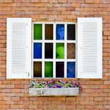 Brick Wall with colorful glasses in White Window and beautiful f Stock Images