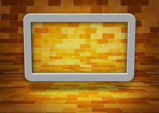 Brick wall. Computer tablet in a brick wall background Royalty Free Stock Photo