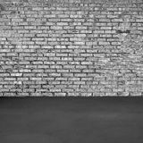 Brick wall and concrete floor Stock Photos
