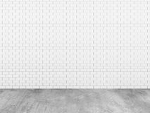 Brick wall with concrete floor Stock Images