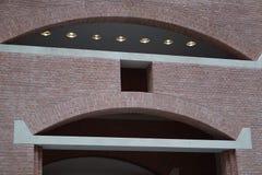 A brick wall with a concrete header. A brick wall with a white concrete arched header Stock Images