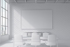 Brick wall conference room with poster Stock Image