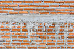 Brick wall construction for house building Stock Photography