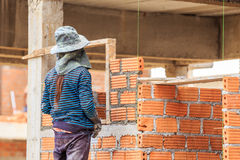 Brick wall construction for house building Stock Photos