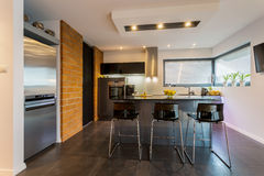 Brick wall in contemporary kitchen Royalty Free Stock Image