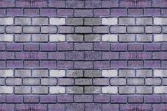 Brick wall contrasting base purple row of bricks gray stone in the center horizontal canvas design urban royalty free stock images