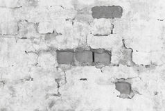 Brick wall covered with broken plaster Royalty Free Stock Photography