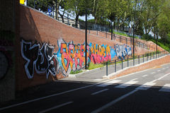 Brick wall covered with graffiti stock photography