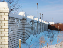 Brick wall, covered with snow Stock Photography