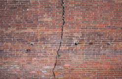 Brick wall with a crack. Texture of a brick wall with a large crack along the entire length Stock Photography