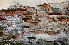 Brick wall with cracked plaster Stock Photos