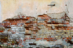 Brick wall with cracked plaster Stock Images