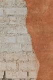 Brick wall with cracked plaster - texture Royalty Free Stock Photography