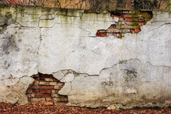 Brick wall  cracked plaster Stock Photos
