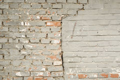 A BRICK WALL WITH CRACKING. TEXTURES OF BRICK WALL AND CRACKING AS BACKGROUNDS Stock Photo