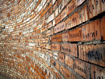 Brick wall with cyrillic names Stock Image