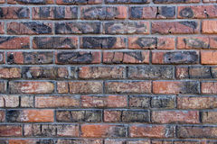 Brick wall damaged by fire. Cracked brick wall damaged by fire stock photography