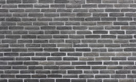 Brick wall of dark bricks Stock Photos