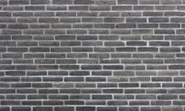 Brick wall of dark bricks Stock Photos