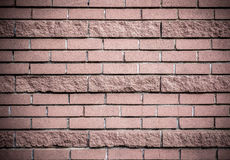 Brick wall of dark-pink brick. A wall of bricks a dark pink Royalty Free Stock Images