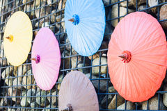 Brick wall decorated with umbrellas Royalty Free Stock Photography
