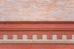 Brick wall with decorative cornice. As background, texture royalty free stock photo