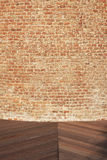 Brick wall detail. Old brick wall detail and wood pavement royalty free stock photos